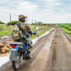 Field Ranger on motorbike patrol, Nambiti Private Game Reserve, KwaZulu Natal, South Africa