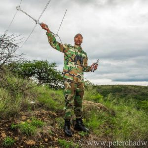 Rhino Monitoring Field Ranger using radio telemetry, Nambiti Private Game Reserve, KwaZulu Natal, South Africa