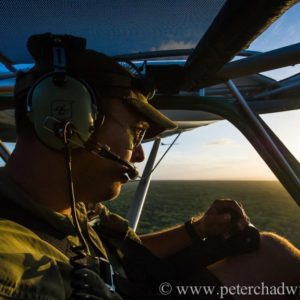 Etienne Gerber, ZAPWING pilot on anti-poaching flight, Phinda private Game Reserve, KwaZulu Natal, South Africa